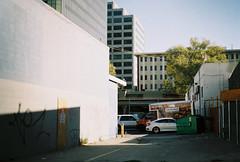 taurinus (jayplorin) Tags: san jose california canon ae1 film buildings city urban cars dumpster windows abandoned kodak gold 200 35mm