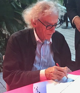 Renowned artist Christo signing his books at PAMM during the opening of his extensive 35 year anniversary of the Surrounded Islands project exhibit.