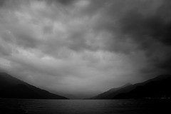 Twilight (stefankamert) Tags: stefankamert twilight dusk landscape black clouds mountains lake water noiretblanc noir blackandwhite blackwhite fullframe mirrorless mood lights sony rx1 rx1r 35mm italy lakecomo comersee bellagio sky