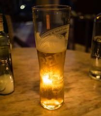 Candle-lit Peroni (wi-fli) Tags: beer peroni italian italia nastroazzuro aqua restaurant bristol whiteladiesroad clifton bar nightlife halfempty halffull drink golden backlit candle candlelit bokeh bokehlicious