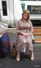 Bag lady (janegeetgirl2) Tags: transvestite crossdresser crossdressing tgirl tv ts heels nylons glamour ankle boots summer shirt dress jane gee outside promenade brighton leopard biker jacket black train station
