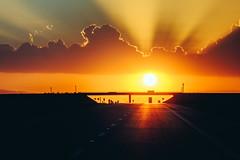 Homeward Bound (scott2click) Tags: sunset car bridge sihllohette flare sky clouds west