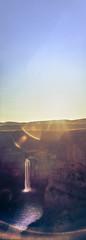 Palouse Falls, Sunrise (Danielle Bednarczyk) Tags: hasselblad xpan hasselbladxpan film slidefilm slide fuji provia fujiprovia provia100 fujiprovia100 palouse wa washington america usa palousefalls waterfall sunrise sun warm sunshine sky canyon ripple water shadow light lightandshadow contrast glow lensflare pano panoramic portraitpano blue orange purple color colour
