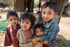 "Children at the ""gas station"", Laos (pas le matin) Tags: laos aisa street portrait lao candid rue travel world asie asia southeastasia voyage children gasstation eos7d 7d stationservice canoneos7d canon bolaven"