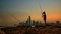 The Huntress (Sanjiban2011) Tags: abudhabi abudhabicorniche abudhabibreakwater uae anglers cityscape skyline earlymorning dawn nature silhouette outdoor sports fishing people nikon d750 tamron tamron2470