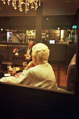 (michel nguie) Tags: michelnguie film analog street lebroutteux bar bistro café vitrine roubaix rbx vertical night granny woman hair