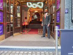 Hippodrome, Charing Cross Road. 20181018T15-40-27Z (fitzrovialitter) Tags: england gbr geo:lat=5151137000 geo:lon=012830000 geotagged leicestersquare unitedkingdom peterfoster fitzrovialitter city camden westminster streets urban street environment london fitzrovia streetphotography documentary authenticstreet reportage photojournalism editorial daybyday journal diary captureone olympusem1markii mzuiko 1240mmpro microfourthirds mft m43 μ43 μft ultragpslogger geosetter exiftool suit doorman entrance passage nightclub casino