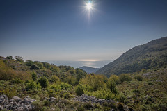 The sea over the mountains (harakis picture) Tags: sun mountain landscape montage mer carlzeiss touit1228