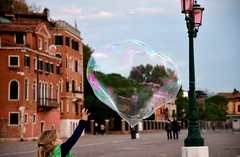 Can I grab the bubble? - not quite! - street life in Venice. (One more shot Rog) Tags: bubbles bubble bubblesgalore venice venetian blow waterfront onemoreshotrog entertain kids playing italian italy pop pops catch soap street streetlife