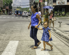 Curious (Beegee49) Tags: street mother daughter crossing filipina bacolod child city philippines girl