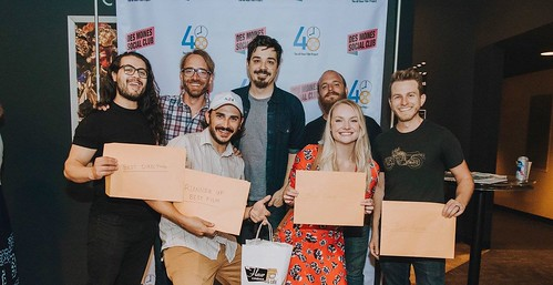 "Cast and crew of ""Note to Self"" holding awards at the Best of City Screening in Des Moines, Iowa"
