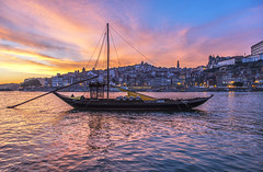 Porto Sunset Blues (mystero233) Tags: porto portugal europe river duoro boat ship water sunset sun reflection town city cityscape ladscape buildings architecture dusk light sky clouds dramatic relax blues rest travel outdoor
