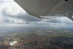 Getting Up There (Nicky Highlander Photography) Tags: barbados caribbean westindies christchurch southern barbadoslightairplaneclub flight airplane aircraft wings light sunlight sunshine clouds horizon open spaces aerial landscape grass field cessna172skyhawk photoessay photojournalism houses nikon d7200 documentary