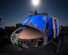 A nose for trouble (Nocturnal Bob) Tags: bell uh1 iroquois huey helicopter wreckage windows parts abandoned airfield canopy long exposure full moon star trails sony a7r lightpainting light painting protomachines radium led6 laowa 15mm f2 zerod
