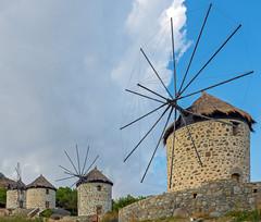 The Windmills at Kontias ( now residential holiday homes) (Limnos - Greece) (Olympus OM-D EM1-II &  M.Zuiko 12-40mm Zoom) (1 of 1) (markdbaynham) Tags: greece greek hellas hellenic greka greekisland greekholiday greeceaegean limnos lemnos northaegean northaegeanisland aegeanisland grecia olympus omd olympusomd olympusgreece olympusem1 mft olympusmft mirrorless evil csc m43 mzuiko mz zd mzd olympusprolens prozoom 1240mm f28 m43rd micro43 em1 em1mk2 em1ii em1mark2 travel micro43rd olympusm43 zuikolic zuikodigital windmill kontias microfourthirds