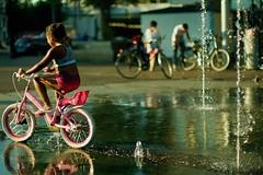 pink bicycle (c222ut2) Tags: haarlemmerplein water girl noctilux amsterdam fun bicycle