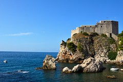 Fortress in Dubrovnik (Yirka51) Tags: boat wave water wall stonewall stone sky seaside sea rock lagoon horizon historical historic hill gulf fort croatia cliff building bluesky architecture adriaticsea