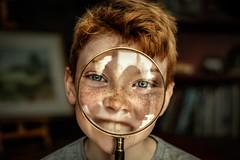 Boy with Eye Glass (Pete Liversidge (plivez)) Tags: boy magnifying glass eye close up fuji film xt2