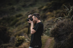A portrait of myself taken by my brother (Moa-photography-nz) Tags: portrait 85mm bokeh adventure travel fun colour mood moody color beach newzealand west coast