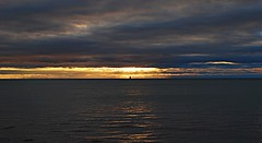 Lone sailboat (Pwern2) Tags: sailboat beach lakeontario ontario greatlakes lakes freshwater water sky sunrise scarboroughbluffs bluffs scarborough sunrays sun sunshine sunbeams toronto the6 6 to navyblue clouds marina pier boating adventure voyage voyaging