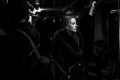 Dark train (_storysofar_) Tags: streetphotography streetportrait portrait girl woman music headphones thoughts darkness blackandwhite monochrome train people subway underground moscow russia fujifilm