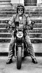 Triumphant Trev! (Missy Jussy) Tags: triumphbonnevillet120black motorbike bike transport trevorkerr charity mentalhealthawareness man prostratecancerawareness building york city candid streetphotography 70200mm ef70200mmf4lusm ef70200mm canon70200mm 5d canon5dmarkll canon5d canoneos5dmarkii canon outdoor outside mono monochrome blackwhite bw blackandwhite portrait