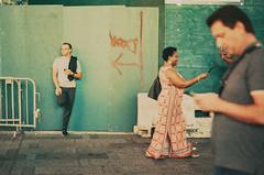 Late night connections... shot on expired Ektachrome film (NYC Macroscopist) Tags: street night phones vintage vintagecolors leica summilux film expiredfilm ektachrome expiredektachrome retrochrome320 nyc newyork timessquare colors pop