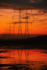 High Voltage (barbara_donders) Tags: sunset zonsopgang red rood reflectie reflection hoogspanning masten pylons electriciteit dof holland