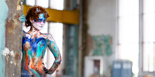 Bodypaint girl is looking at the photographers