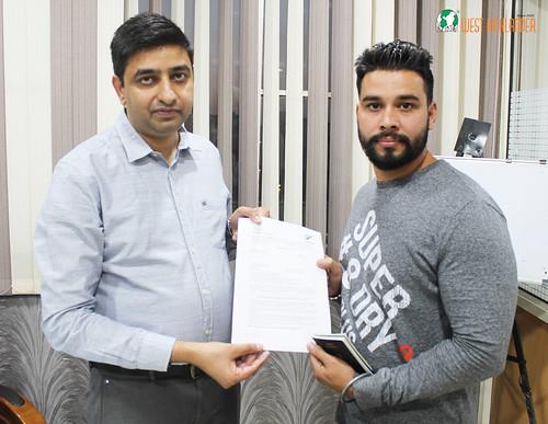 Mr. Gurvinder Singh (Director of West Highlander) handing over New Zealand Dependent Visitor Visa to Damanpreet Singh Brar