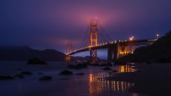Magenta Madness (carolina_sky) Tags: goldengatebridge sanfrancisco fog marinelayer bluehour reflection lights bakerbeach rocks ocean pacific california skymatthewsphotography pentaxk1 pentax2470mm magenta