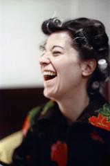 50-327 (ndpa / s. lundeen, archivist) Tags: nick dewolf nickdewolf color photographbynickdewolf 1973 1970s film 35mm 50 reel50 winter maine centralmaine greenville greenvilleinn people familyandfriends woman brunette haircurlers schenck sudieschenck laugh laughter laughing trip wintertrip vacation
