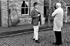 Neighbourly Discussion (WorcesterBarry) Tags: blackwhite bnw blackandwhite buildings england places people photographers paths street streetphotography streetphoto cobbles candid lovebw monochrome love urban outdoors humour funny guys travel blackcountrymuseumn adventure windows