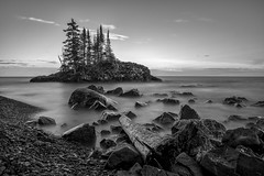 Evening light (Paul Domsten) Tags: lakesuperior minnesota northshore blackandwhite monochrome mono water lake pentax longexposure rocks tombolo shore landscape