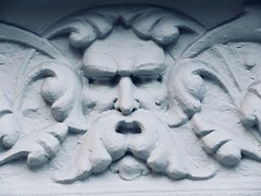 Green Man Gargoyle on Building Facade 4774 (Brechtbug) Tags: green man gargoyle building facade 25th street between 7th 8th avenues nyc 11122018 new york city midtown manhattan 2018 gargoyles portraits monster portrait monsters creature faces spooky art architecture sculpture keystone mask brownstone brown stone