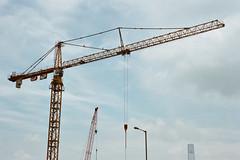 """city sky"" (hugo poon - one day in my life) Tags: nikonfe2 nikon50mm18 film kodakportra400 hongkong causewaybay icc gloucesterroad city urban constructioncity sky blue skyscraper streetlamp crane"