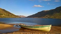 Lough Nafooey (mcginley2012) Tags: loughnafooey connemara lake boat landscape mountain scenic sand trees ireland cameraphone microsoftlumia650 light