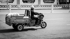Safety first (Go-tea 郭天) Tags: qingdao shandong man motorcycle motorbike ride ridding road movement helmet construction site safety security head protection protected worker old alone lonely cabbage packed trunk sun sunny shadow delivery busy work working duty business delivering canon eos 100d 50mm prime street urban city outside outdoor people candid bw bnw black white blackwhite blackandwhite monochrome naturallight natural light asia asian china chinese job