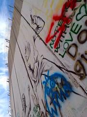 Israeli-built West Bank Wall surrounding Bethlehem with mural art, Bethlehem, West Bank, Israel (anthonyasael) Tags: anthonyasael asael westbank bethlechem betlehem bethlehem palestine israel middleeast asia mural art muralart colorful painting graffiti fresco drawing street streetart banksy artist politicsandgovernment buildstructure exterior buildingexterior wall separationwall concrete separation vertical nopeople israelpalestine