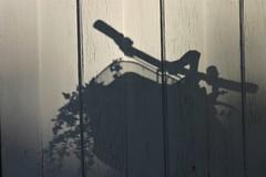 shadow bicycle (EllaH52) Tags: bicycle shadow blackwhite monochrome greyscale wall cracks lines