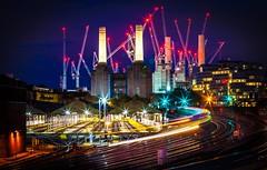 Animals (Jonathan Vowles) Tags: battersea power coal starburst night london rails railway signals train blur motion chimney stacks pink floyd animals