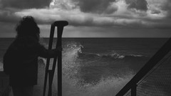 the little girl & the sea (frax[be]) Tags: atmosphere streetphotography sea dark waves rokkor 28mm fuji clouds outdoor highcontrast noiretblanc monochrome noir poetry composition kid blackandwhite bw blackwhitephotos