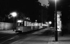 Berlin Ost, Ende (peter.velthoen) Tags: lijn46 trabant eindpunt eindpuntddr tram nacht zwartwit nikkor ilfordfp4 film scan ddr endpunkt berlin strasenbahn strase kunstlicht pkw amkupfergraben te217051217100 strasenbahnlinie46 nophotoshop road building strasenbahnlinie haltestelle endpunktschleife stadt trabi reclamezuil werbesäule laterne stoep bürgersteig trottoir neg23735 petervelthoen