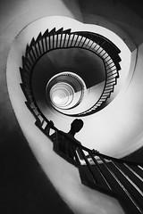 losing yourself (/ urban.fishing /) Tags: spiral stair black white humaningeometry up shadow silhouette dream nightmare ljubljana skyscraper