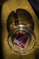 It's Fun To Fly (Curtis Gregory Perry) Tags: ashtray ash tray yellow table formica glass sunlight nikon d810 plane airplane champion aviation spark plugs