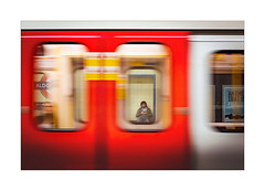 Sliding Doors (Dave Fieldhouse Photography) Tags: streetphotography street london underground tube londonunderground colour phone telephone mobilephone project blur motionblur motion aldgateeast station texting fujixpro2 fujifilm fuji experimental appicoftheweek
