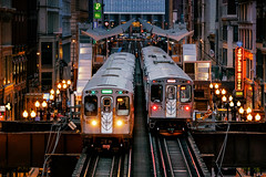 Bling on the Night (Carl's Captures) Tags: cta chicagotransitauthority chicagoillinois cityofchicago urban masstransit publictransportation elevated architecture cityscape downtown cookcounty thewindycity chitown ltrains eltrains meetup passing doubletrack carriages coaches theloop jewelersrowdistrict wabashavenue greenline brownline streetlights evening dusk september tracks signage sign neon headlights taillights streetscape landscape busy bustling crowded retail stores wholesale nikond7500 sigma18300 photoshopbyfehlfarben thanksbinexo