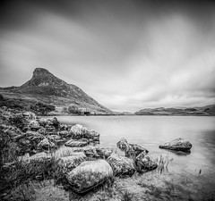 At the waters edge (grbush) Tags: cregennan snowdonia northwales lake water rocks mountain longexposure blackwhite bw monochrome sonyilce7 tokinaatx116prodxaf1116mmf28 cregennanlakes