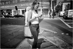 Lost in Text (Steve Lundqvist) Tags: portrait persone ritratto street road crossroad streetphotography strada women sidewalk english london londra inghilterra england uk britain british life beautiful beauty fashion moda mood attractive hair location contact people cover model atmosphere ambiance seductive young cute lifestyle intimacy boudoir shooting posh beau hairstyle pose posed leica q cellulare cell telephone chat chatting texting candid