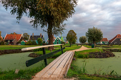 Wooden  walkway. (rudi.verschoren) Tags: wooden wood trees landscape houses farms nature light lines leaves reflection overlooking pittoresque holland heritage sky green glow grass mood water walkway canon colors contrast mills